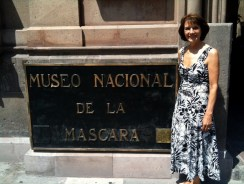 Susan in front of mascara sign