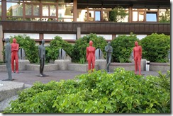 Sculptures in front of Apartment Building