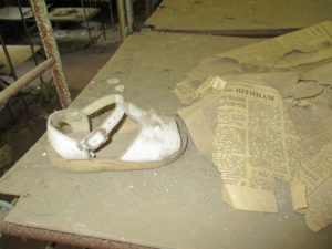 Abandoned shoes and relics of a once safe and happy life