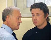 John D'Abbro (left) shares a moment with Jamie Oliver during filming for Dream School.