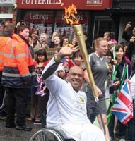 Gobi with the Olympic flame in Stevenage in July 2012.
