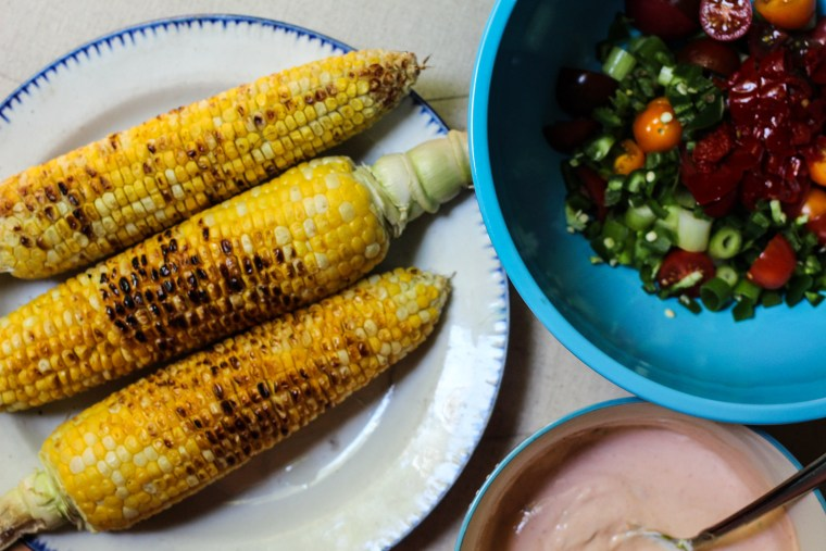 Grilled Corn, Cherry Pepper and Tomato Salad with Yogurt, Lime, and Siracha Dressing