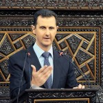 Syria President Bashar Assad speaks at parliament in Damascus.