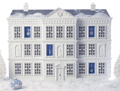 A Photo of Harrod's White And Blue Advent Calendar House Which Has A Present Behind Every Door