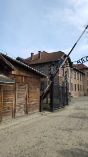 """The Infamous gate of Auschwitz I, with the beginning of the wording """"Arbeit Macht Frei"""" (work sets you free)"""