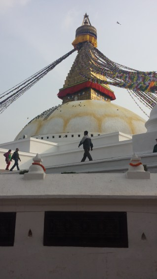 Men walking on the edge of Boudhanath Stupa