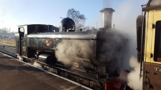 The train engine, steaming away!
