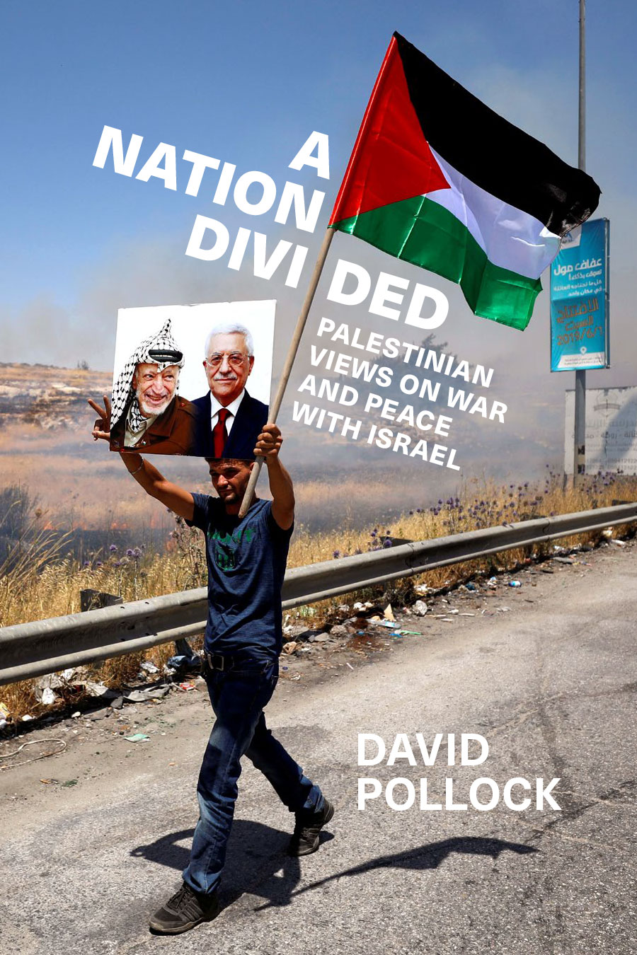 Book cover showing a man holding a Palestinian flag and a photo