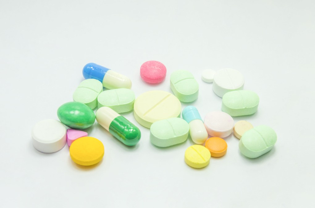 Tablets in all shapes, colours and sizes are depicted against a white background.