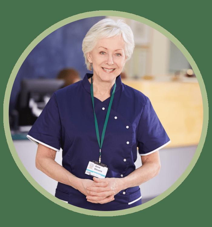 Nurse smiling inside a hospital