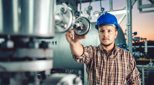 Man using tablet at Natural gas processing facility