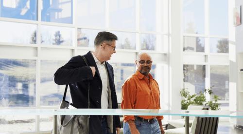 two men walking inside a smart building