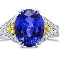 A Gorgeous 4.59 Cts Sapphire Side Diamonds Engagement Side Stone Ring Set in Platinum
