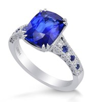 A Spectacular 3.93 Cts Sapphire Side Diamonds Engagement Side Stone Ring Set in Platinum