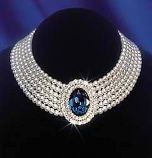 Princess Diana's six strand pearl choker with a lush sapphire in the center