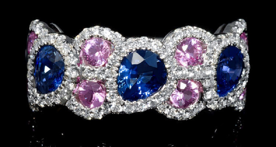18k White Gold Diamond and Sapphire Ring This elegant 18k white gold ring, features 110 round brilliant cut white diamonds of F color, VS2 clarity, of excellent cut and brilliance, weighing .46 carat total, with 8 pink sapphires, of exquisite color, weighing .73 carat total and 3 pear cut blue sapphires, of exquisite color, weighing 1.28 carats total.