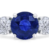 A Magnificent Round Ceylon Sapphire and Diamond Ring
