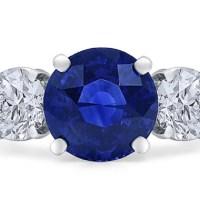 A Magnificent Round Ceylon Sapphire and Diamond Ring