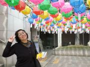 Sis. T and Lanterns for Buddhas Birthday outside of a Buddhist place