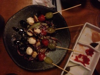 Cheese, tomato, chestnut, and grape on a stick