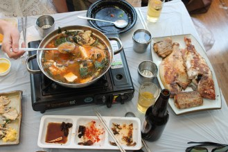 Seafood soup (had a fish head floating around) at the fresh fish market in Busan, Korea