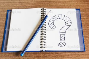 Open Notebook and pencil writing question mark on it