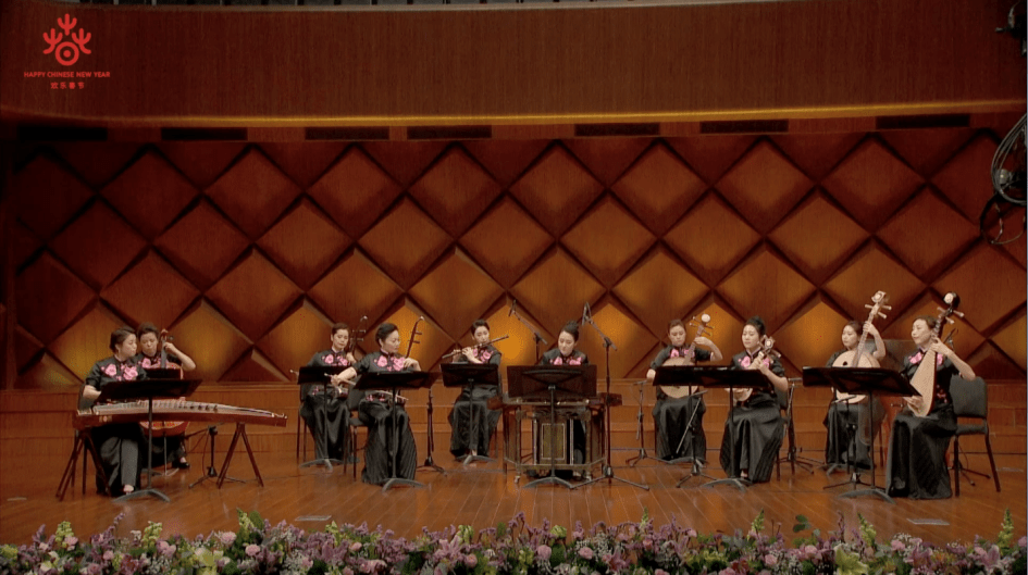 A group of people playing instruments  Description automatically generated with medium confidence