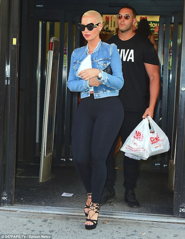 Photos: Amber Rose Flaunts Her Sensational Curves As She Steps Out In Leggings And Crop Top