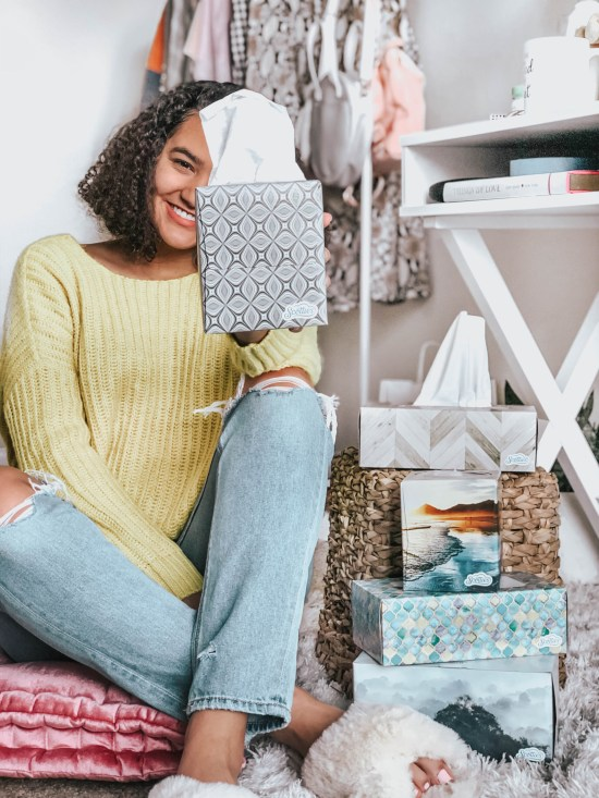 Girl Sitting on a Floor Cushion and holding a box of Scotties tissues