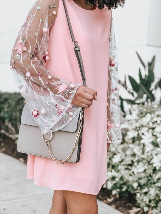 Pink Shift Dress with 3D Embellished Sleeves and a Slate Gray Ring Crossbody Bag