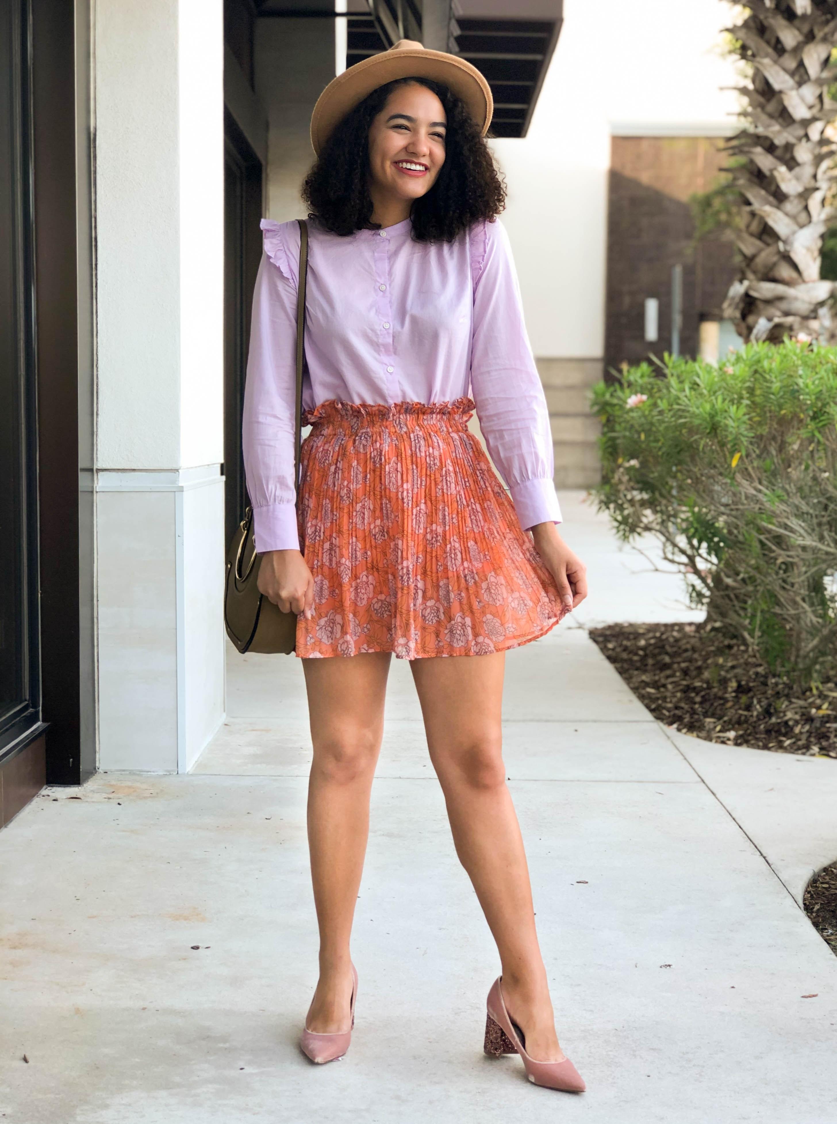 Floral Chicwish Skirt, Purple Ruffle Sleeve Top, Pink Velvet Block Heels, Tan Panama Hat, and a Saddle bag