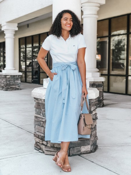 Vineyard Vines White Polo, Striped Maxi Skirt with Belt, Beige Block Heels, and a Beige Ring Bag