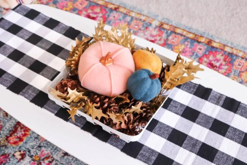 Pastel Colored Pumpkins in a Farmhouse Basket on a Coffee Table