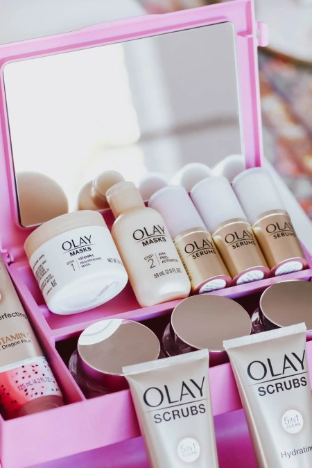 Olay beauty products in a pink caboodle