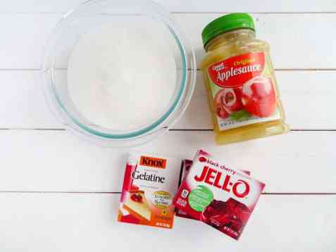 a glass bowl of sugar, a jar of applesauce, boxes of gelatine and jell-o