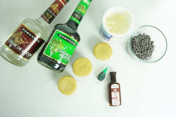 ingredients for boozy andes mint cupcakes on a white table