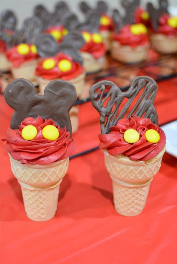 mickey mouse cupcake cones on a red cloth