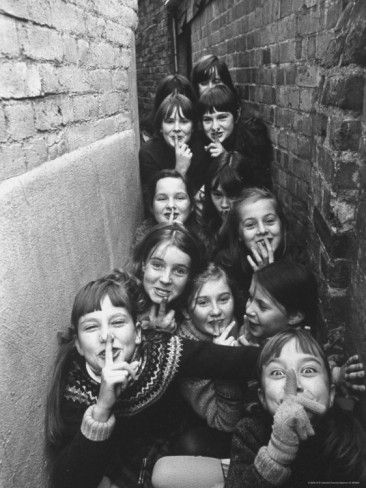 16 - 1970. Children playing outdoor games in London suburbs. Photo by Terence Spencer.
