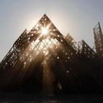 """The sun sets over the """"Cradle of Mir"""" art installation at the 2013 Burning Man arts and music festival in the Black Rock desert of Nevada"""