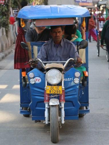 indian tuk-tuk driver in Delhi, India