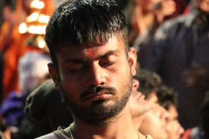 indian man meditating in Rishikesh, India