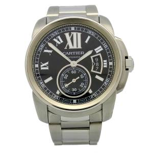 Cartier Calibre de Cartier in stainless steel. Black dial with Roman numeral hour markers