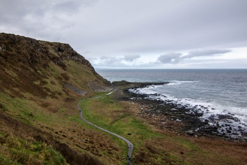 The road from the Chimney Stacks to the basalt pavement of Giant's Causeway, named after a legend about a giant striding from here to Scotland.