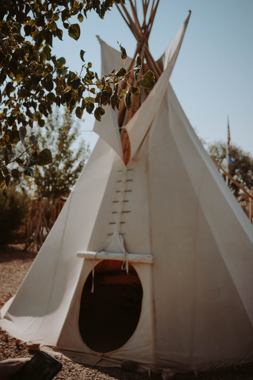 white teepee located in nature