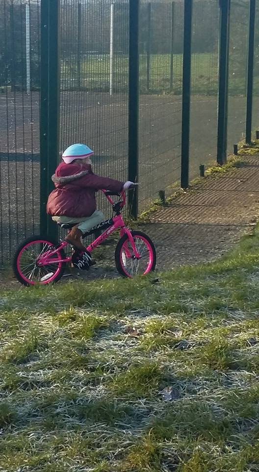 Caitlin riding her BMX bike - Serenity You