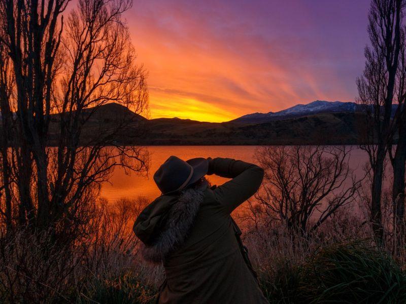 Girl lake New Zealand sunset
