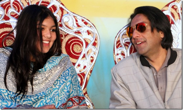 paras shah and daughter purnika smile on stage