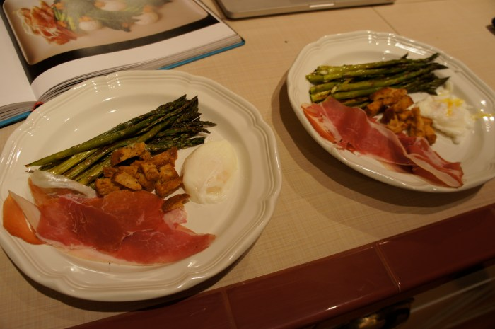 Asparagus salad with croutons, prosciutto, and poached eggs