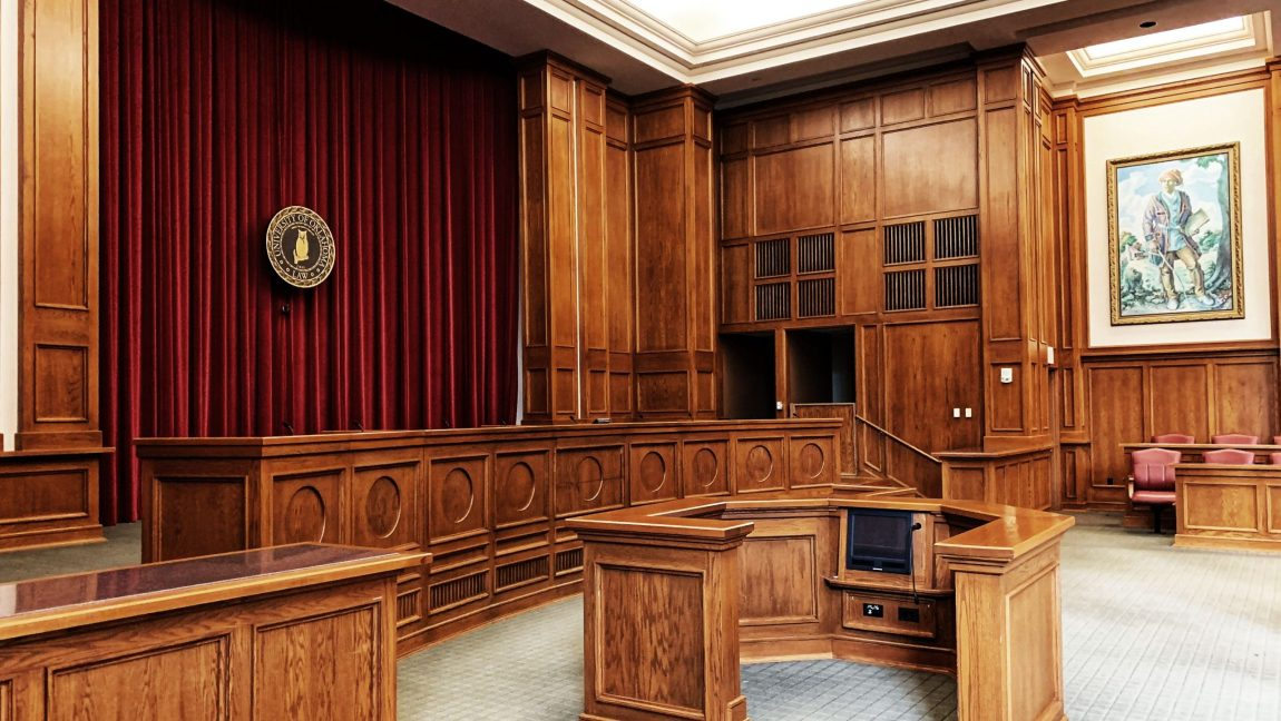 Photo of a courtroom before jurors arrive for jury duty.