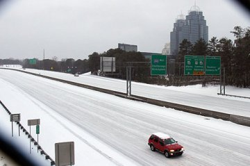 Almost empty Atlanta's I-285 morning after snow
